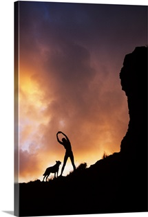 Hawaii, Silhouette Of A Woman Stretching On A Mountain Top At Sunset