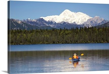 Man paddling a Klepper kayak on Byers Lake at Denali State Park with Mt. McKinley