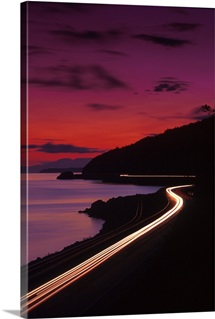 Seward highway, traffic w/ lights Southcentral Alaska summer night railroad tracks