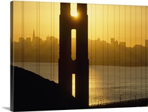 Sunrise Behind The Golden Gate Bridge With Skyline Behind; San Francisco, California