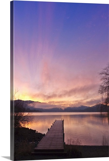 Sunrise over a dock in Lake Whatcom during Winter Bellingham Washington