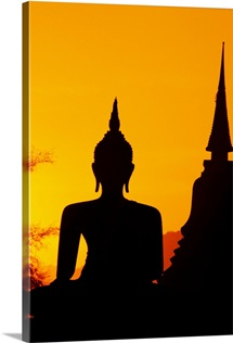 Thailand, Sukhothai, Buddha And Temple Silhouetted At Sunset