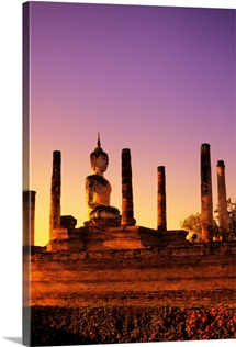 Thailand, Sukhothai, Wat Mahathat, Buddha Statue With Many Pillars At Sunset