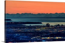 The city of Anchorage Alaska at sunset with Cook Inlet in the background