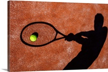 Tennis Player's Shadow on a Tennis Court