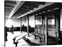 The onboard gym on the Titanic showing the rowing machines and exercise bikes, 1912
