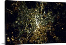 Berlin at night, from space. The light bulbs still show the East/West division.