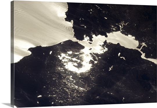 San Francisco Bay Area. The sun glint really shows the water and cloud flows