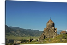 Catholic church behind cemetery with old grave stones, Lori province, Armenia