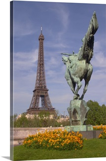 Eiffel Tower in Paris with a statue of a horse seen from behind