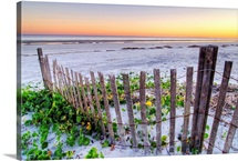 A beach fence at sunset on Hilton Head Island, South Carolina.