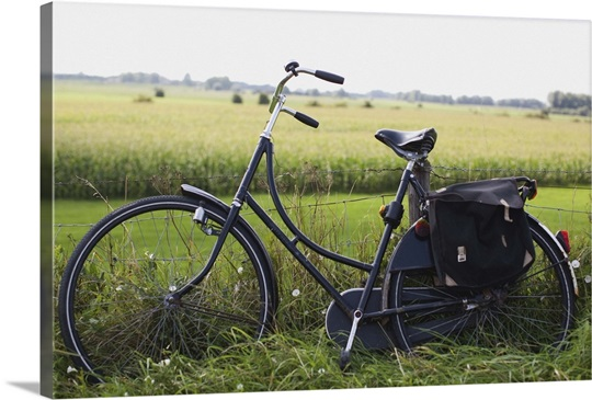 a bike resting along a fence in the countryside photo canvas print great big canvas. Black Bedroom Furniture Sets. Home Design Ideas