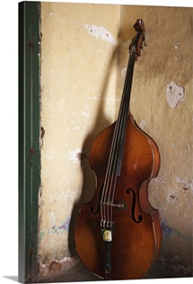 A double bass in the corner of a room