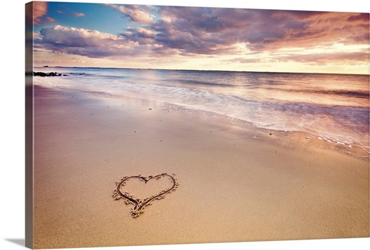 A heart in the sand on a Dutch beach during sunset. Photo ...
