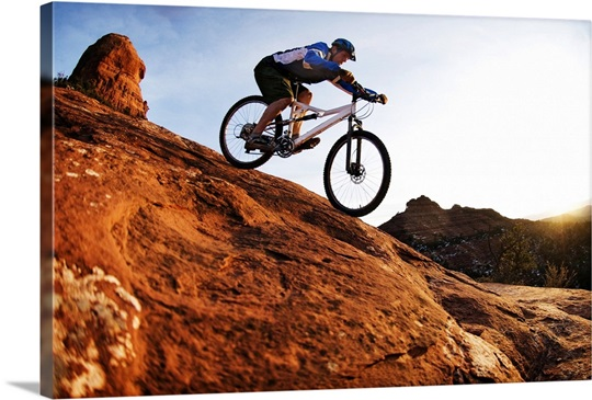 a man rides his mountain bike through the red rock country around sedona photo canvas print. Black Bedroom Furniture Sets. Home Design Ideas