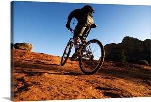 a man rides his mountain bike through the red rock country of sedona az photo canvas print. Black Bedroom Furniture Sets. Home Design Ideas
