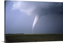 A slender white tornado churns across farmland near Stuart Nebraska on June 9th, 2003.