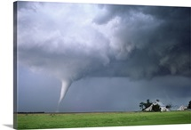 A strong tornado approaches a farmstead in Nebraska on June 9th, 2003.