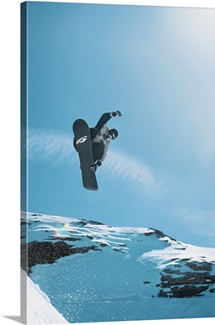 action shot of a snowboarder doing a grab