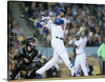 Adrian Gonzalez of the Los Angeles Dodgers hits an RBI single in the seventh inning