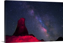 Alabama Hills, rock tower painted with red light with stars and Milky way in sky