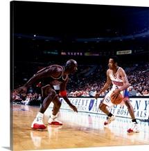 Allen Iverson of the Philadelphia 76ers faces off against Michael Jordan