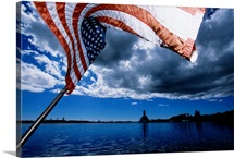 American flag waving in the wind on the water