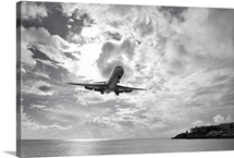 An airliner comes in for a landing in St Maarten, Netherlands Antilles.