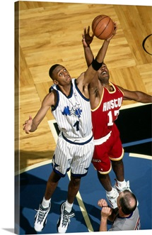 Anfernee Hardaway of the Orlando Magic battles for the rebound