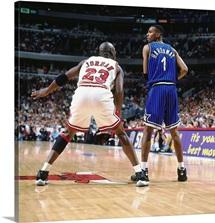 Anfernee Hardaway of the Orlando Magic looks to make a move against Michael Jordan
