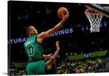 Avery Bradley of the Boston Celtics lays in a basket against Kent Bazemore