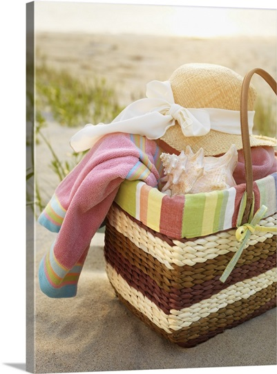 Towel Art Basket : Basket at beach with seashells a hat and towel photo