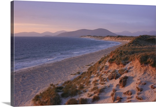 Beach and dunes at sunset on the island of Berneray in the Outer Hebrides, Scotland.