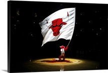 Benny the Bull, mascot for the Chicago Bulls, waves a giant flag with the Bulls' logo