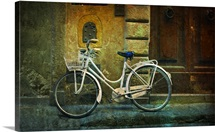 Bicycle Leaning Against Wall with Old Wooden Door
