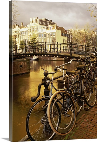 bicycles leaning by the railing of a canal amsterdam photo canvas print great big canvas. Black Bedroom Furniture Sets. Home Design Ideas