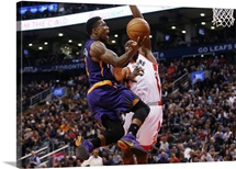 Bismack Biyombo 8 of the Toronto Raptors defends