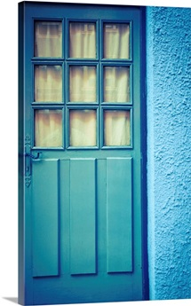 Blue door with blue wall.
