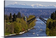 Boats passing under Montlake drawbridge between lake Washington and lake Union.