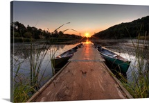 Canoes on the Dock at Sunrise