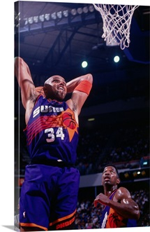 Charles Barkley 34 of the Phoenix Suns dunks against the Sacramento Kings
