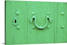 Close-up of green door with door knocker