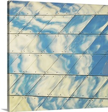 Cloud reflections on building mirror.