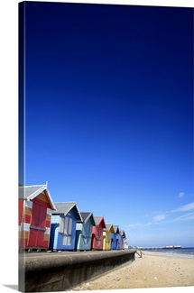 Colourful wooden beach huts on the promenade at Cromer town, North Norfolk Coast
