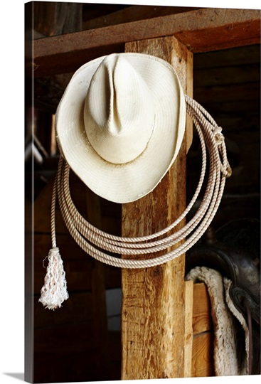 Cowboy Hat Hanging In Barn With Rope Photo Canvas Print