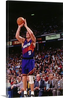 Dan Majerle 9 of the Phoenix Suns shoots against the Sacramento Kings