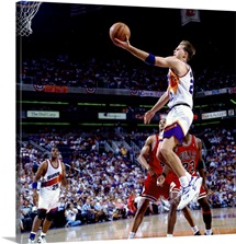 Danny Ainge 22 of the Phoenix Suns attempts a layup against the Chicago Bulls