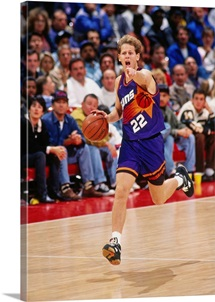 Danny Ainge 22 of the Phoenix Suns dribbles circa 1993 at the America West Arena