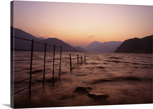 Dawn view along Ennerdale lake towards Pillar in winter