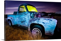 Derelict pickup truck at night